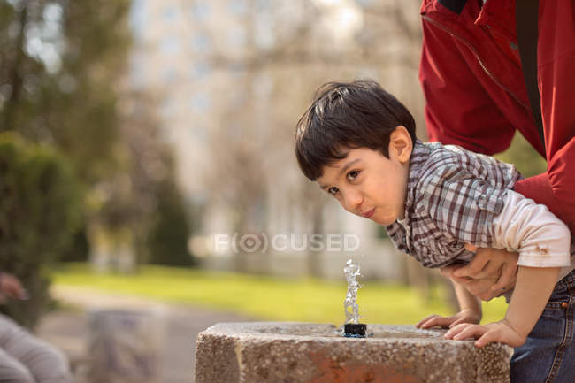 Boy drinking water — Stock Photo
