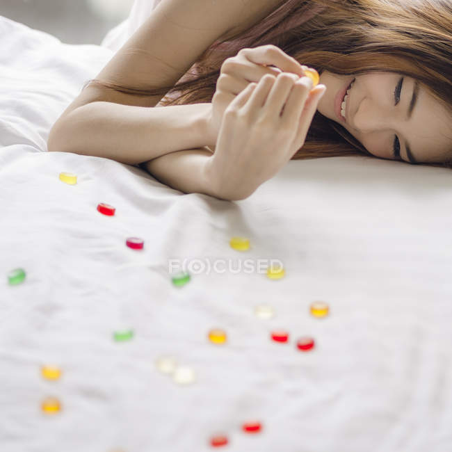 Portrait of young woman on bed — Stock Photo