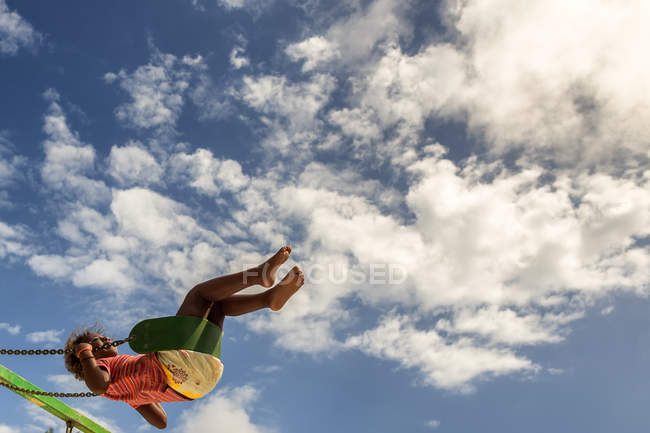 Girl on swing mid air — Stock Photo