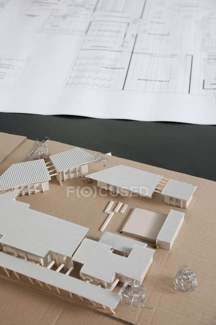 Close-up of architectural plans and model — Stock Photo