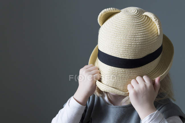 Girl pulling hat down over face — Stock Photo