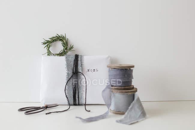 Wrapped christmas present — Stock Photo