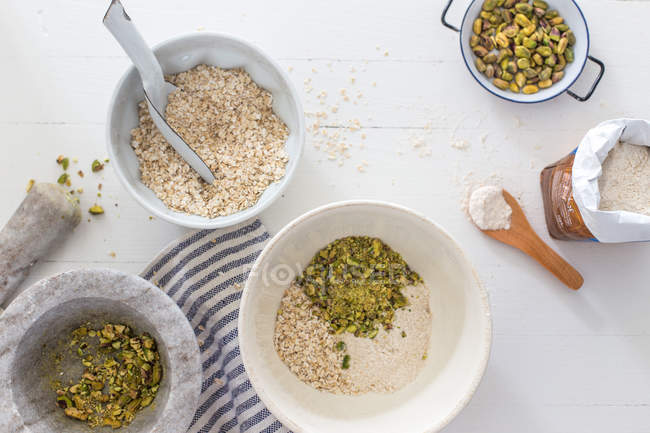 Ingredients for baking pistachio cupcakes — Stock Photo