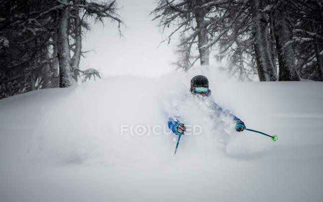 Male skier enjoying deep powder skiing — Stock Photo