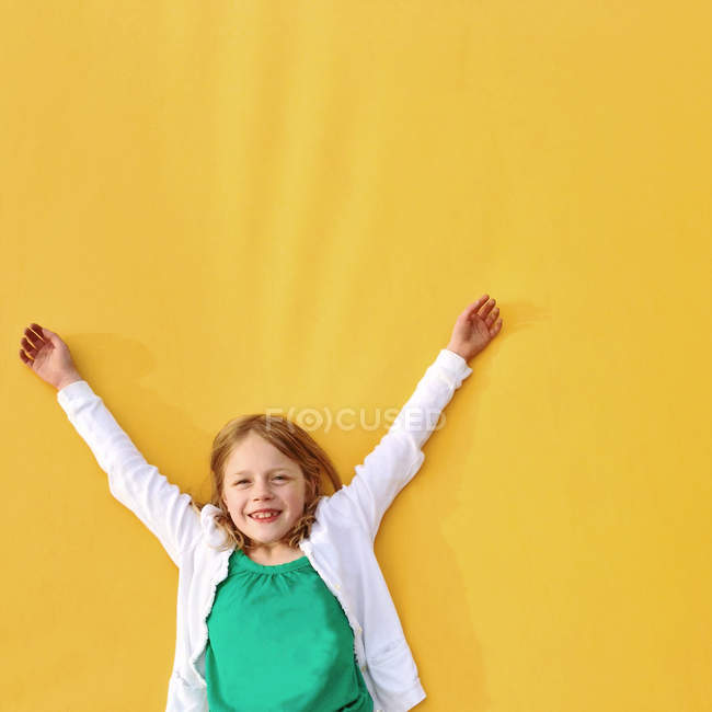 Girl with her arms in the air — Stock Photo