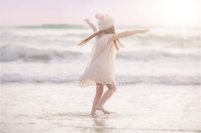 Girl dancing on beach — Stock Photo