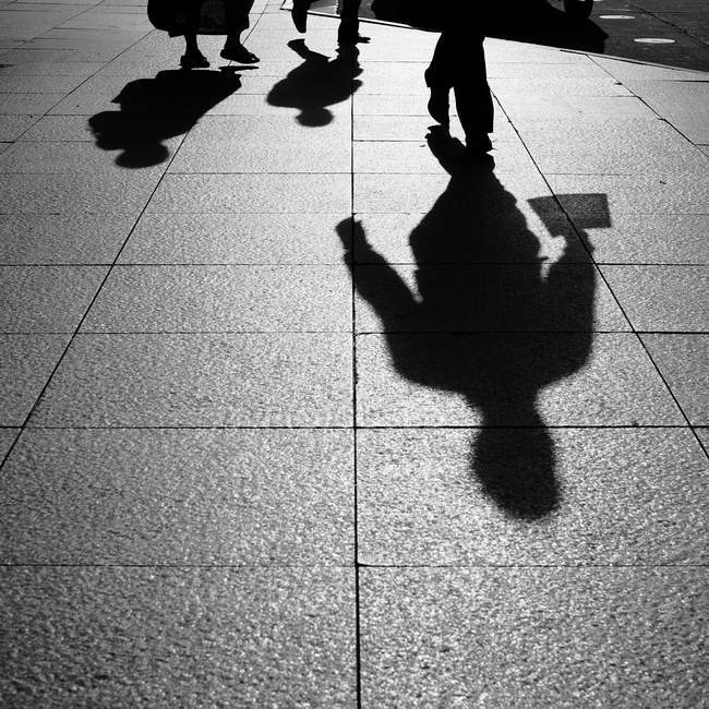 Shadows and Silhouettes of people on street — Stock Photo
