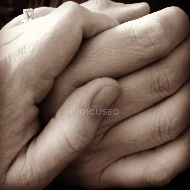 Little hand holding bigger hand — Stock Photo