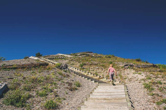 Boy walking on stairs — Stock Photo
