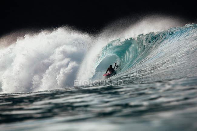 Man bodyboarding in Caribbean — Stock Photo