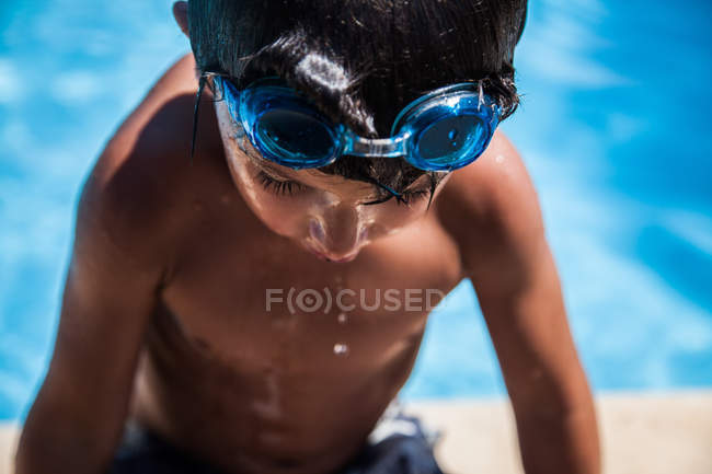 Boy getting out of pool — Stock Photo