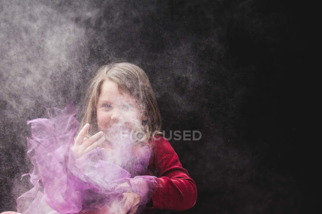 Girl playing in dust — Stock Photo