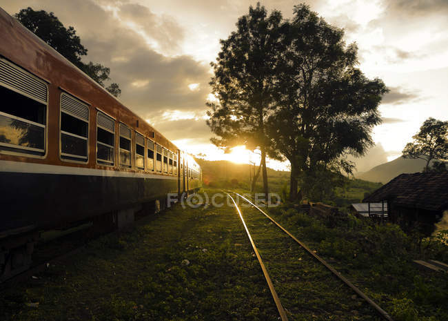 Train driving through rural landscape — Stock Photo