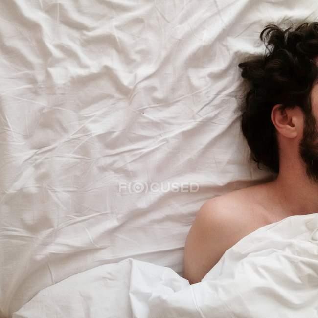 Bearded man sleeping in bed — Stock Photo