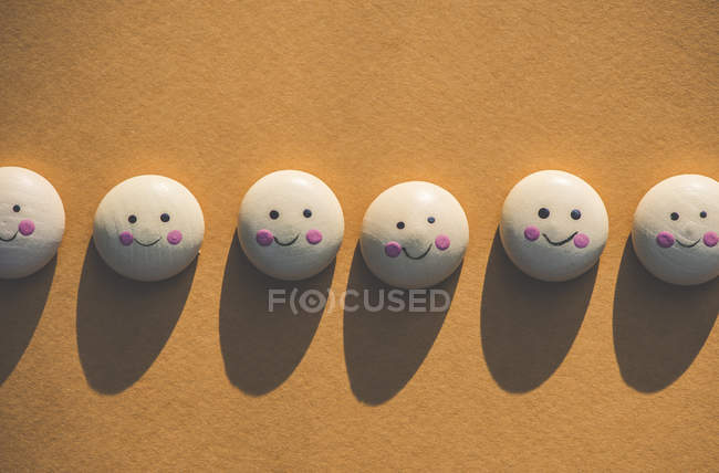 Smile icons on textile surface with points. — Stock Photo