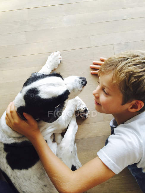 Boy playing with dog — Stock Photo