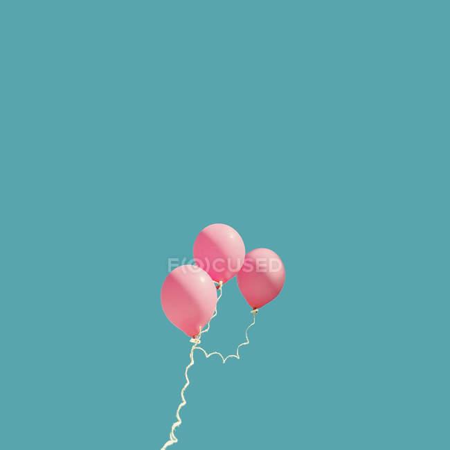 Three pink balloons — Stock Photo