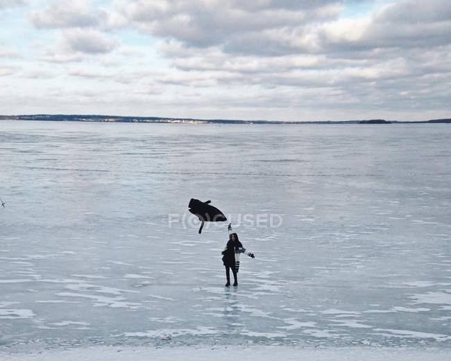 Woman standing on frozen sea — Stock Photo