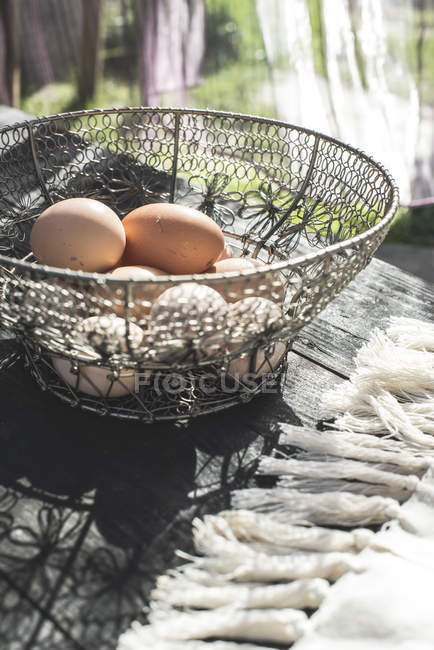 Metal basket with eggs. — Stock Photo