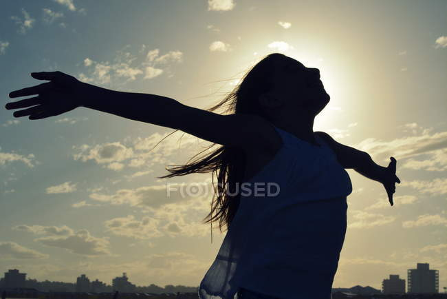 Girl standing with outstretched arms — Stock Photo