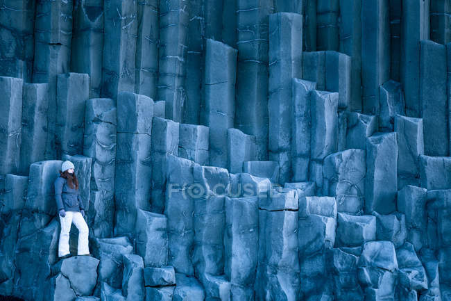 Woman standing on basalt columns — Stock Photo