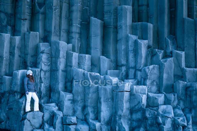 Woman standing on basalt columns — Stock Photo