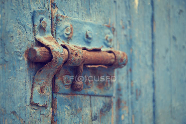 Rusty bolt on wooden door — Stock Photo