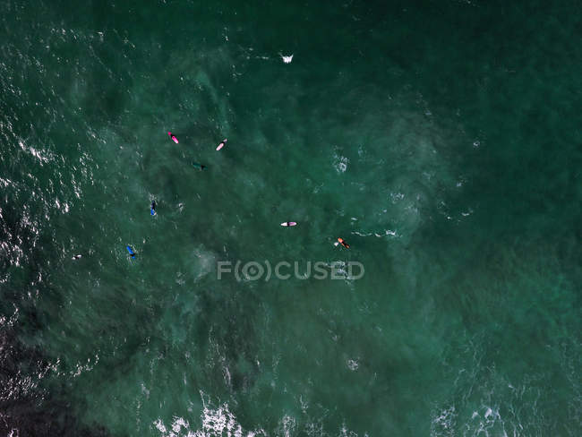 Overhead view of Surfers in sea — Stock Photo