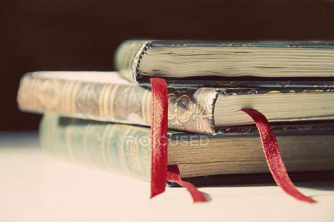Stack of books with red tassels — Stock Photo
