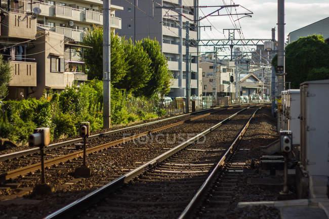 Railway tracks through city — Stock Photo