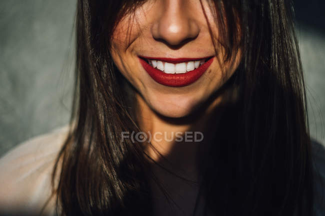 Smiling woman with red lipstick — Stock Photo