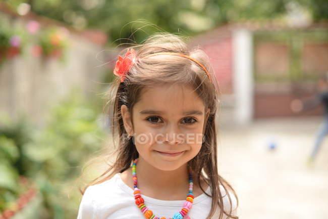 Girl and looking at camera — Stock Photo