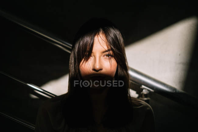 Portrait of womans face in shadow — Stock Photo