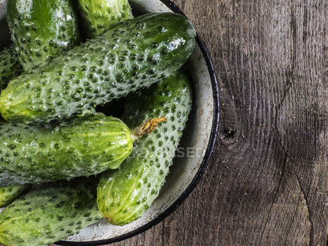 Cucmbers on wooden surface — Stock Photo