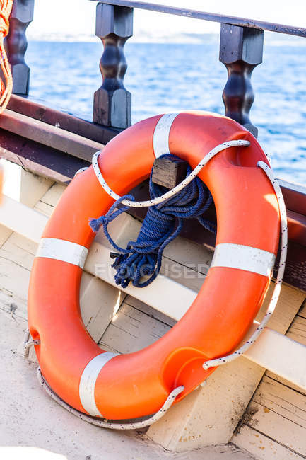 Orange life buoy on boat — Fotografia de Stock