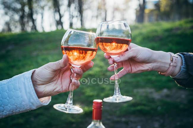 Women making celebratory toast with glasses — Stock Photo