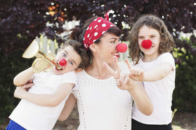 Mother with son and daughter dressed as clowns — Stock Photo