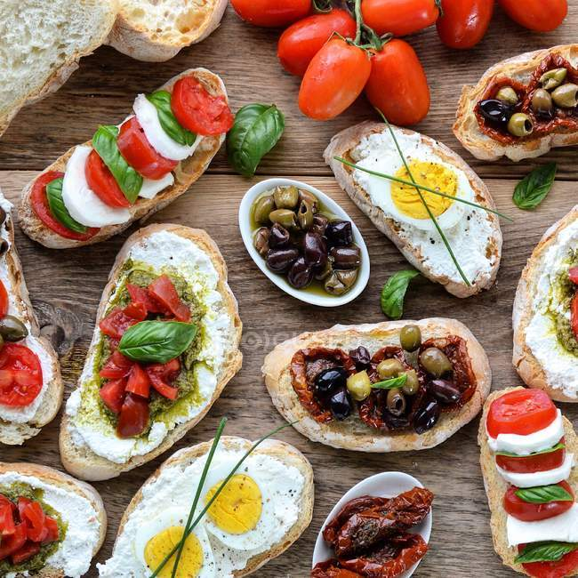 Bruschetta selection on table — Stock Photo