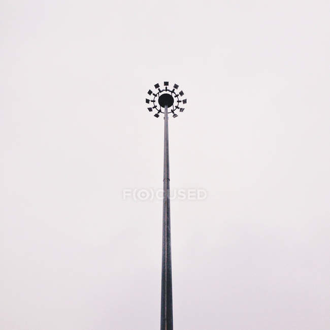 Low angle view of street light against white background — Stock Photo