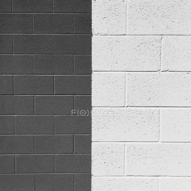 Close up of a half grey and half white brick wall — Stock Photo
