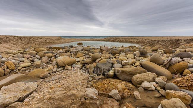 Scenic view of rocks on the beach, Lagos, Faro, Portugal — Stock Photo