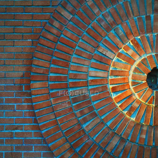 Sun made out of red bricks in a circle pattern — Stockfoto