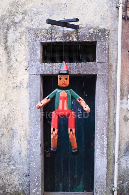 Traditional wooden puppet hanging outdoors — Stockfoto