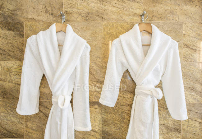 abe6f1b937 Two bathrobes on hangers in bathroom — Stock Photo