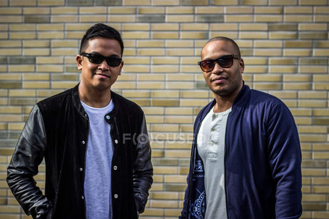 Two cool african american friends in sunglasses posing to camera — Stock Photo