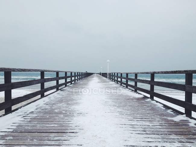 Scenic view of snow covered pier in winter — Stock Photo