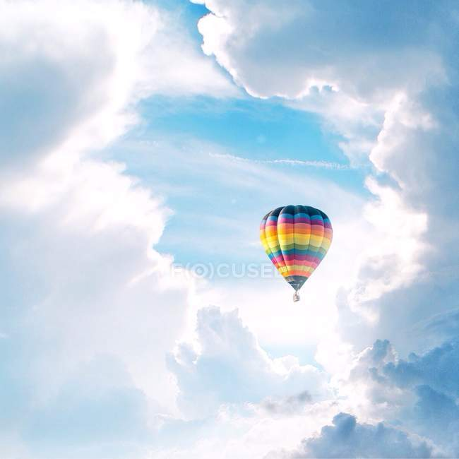 Scenic view of hot air balloon in clouds — Stock Photo