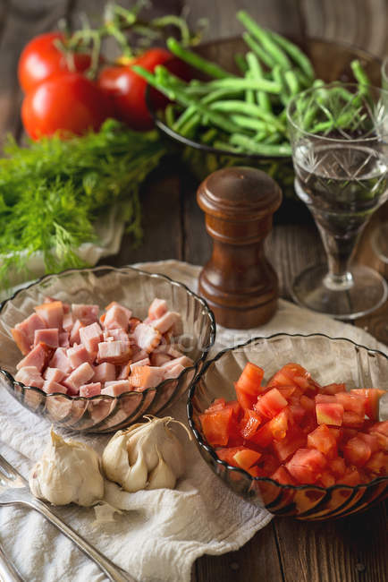 Tasty Cooking Ingredients on rural kitchen table — Stock Photo