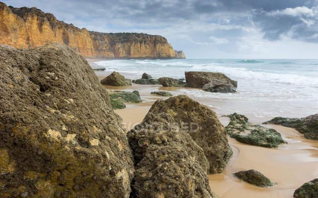 Cliffs and beach, Carvoeiro, Faro, Portugal — Stock Photo