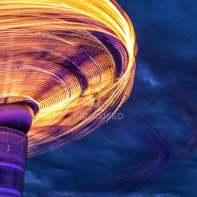 Blurred motion of side of carousel — Stock Photo